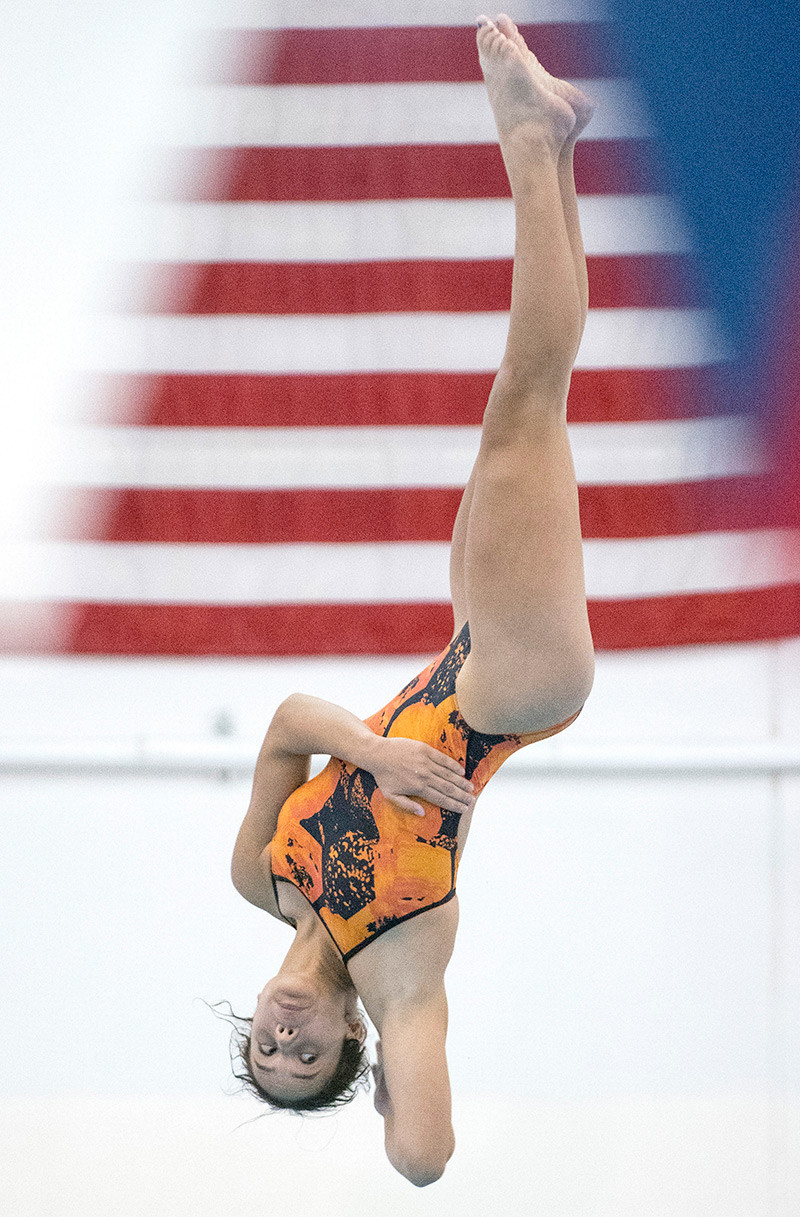 Emma Karhu makes the most of her fifth round dive, helping her to a third place finish in the event. Karhu also sang the National Anthem at the opening of the Gene Dozah Invitational swim meet and competed in the 50 free.