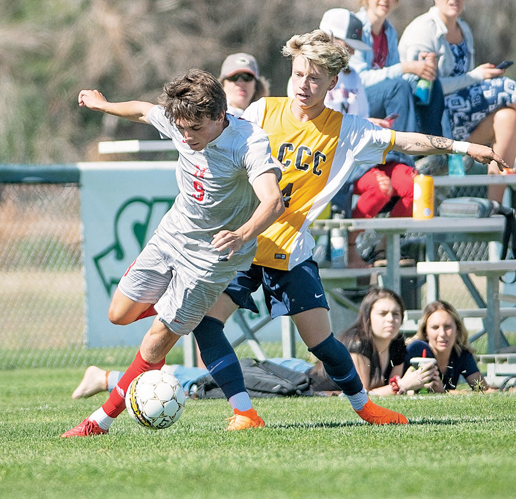 Trapper forward Jarrett Shrum battles LCCC's Parker Longbottom for possession of the ball during a game at Trapper Field earlier this season. NWC lost the first contest 2-0, but battled back for a 0-0 tie in a Saturday rematch.