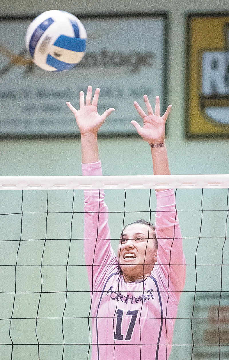 NWC sophomore Demery Dean goes up for a block Saturday in a match against Eastern Wyoming College at Cabre Gym. The Lady Trappers swept the Lancers in three sets 25-20, 25-17, 25-23.