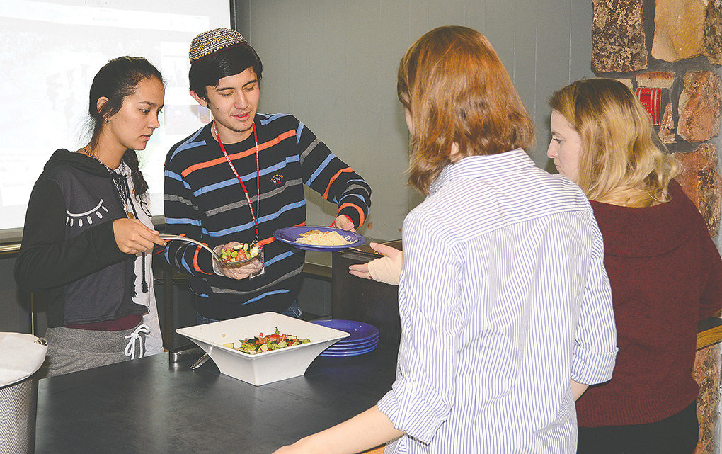 Northwest College students Bossan Abdyyeva (left) and Tair Masharipov serve the Turkmen cuisine they prepared for NWC's Intercultural Tuesday Lunch last week at the DeWitt Student Center. Abdyyeva and Masharipov are from Turkmenistan, which borders Iran and Afghanistan in central Asia.