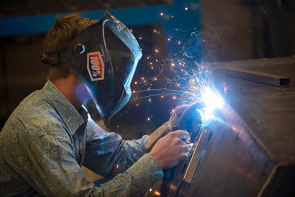 Powell High School student Corey Linebaugh works on a grill project during a recent welding class. High school welding and industrial art students may soon be working on projects for a new agricultural facility.