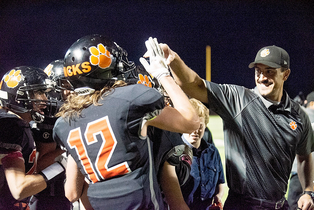 Powell head football coach Aaron Papich celebrates with senior Trent Dicks and the rest of the Panther sideline following Colton Johannsen's interception for a touchdown against Jackson Friday night. Powell lost to the Broncs 34-13.