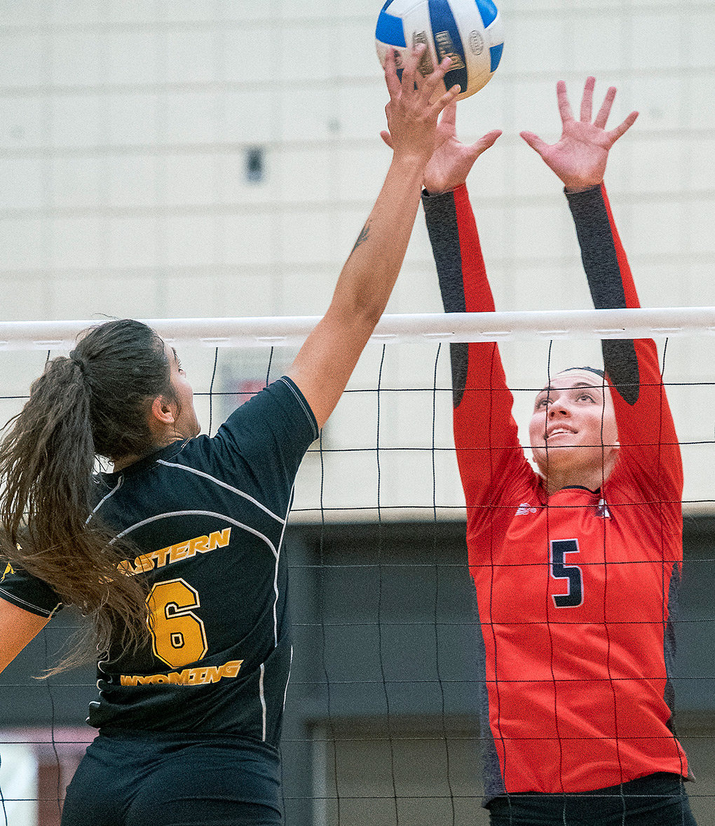 Northwest outside hitter Shania Warren goes up for a block against EWC's Lissette Lefforge Saturday in Torrington. The Lady Trappers won the match in straight sets, 25-23, 25-17, 25-20.