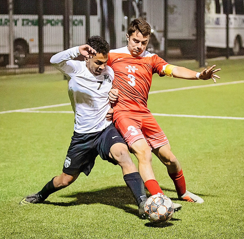Northwest defender Edgar Meza battles Sheridan's Nicolas Parris for possession of the ball.