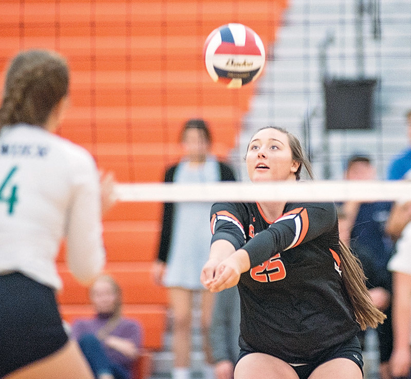 Powell's Rachel Bonander bumps a shot during a home match against Lander earlier this season.