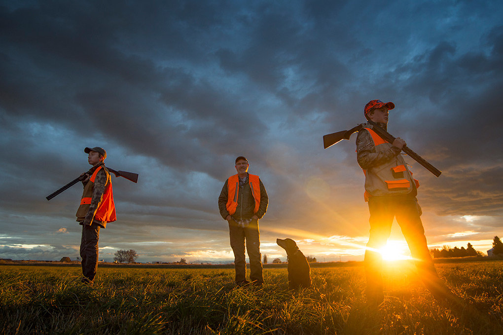 Kalin (left) and Keegan Hicswa (right) wait for sunrise to begin their opening day pheasant hunt with their father, Scott Hicswa, and chocolate lab Meg. The family made sure to get some time in afield before continuing with their busy weekend of sports and special events.