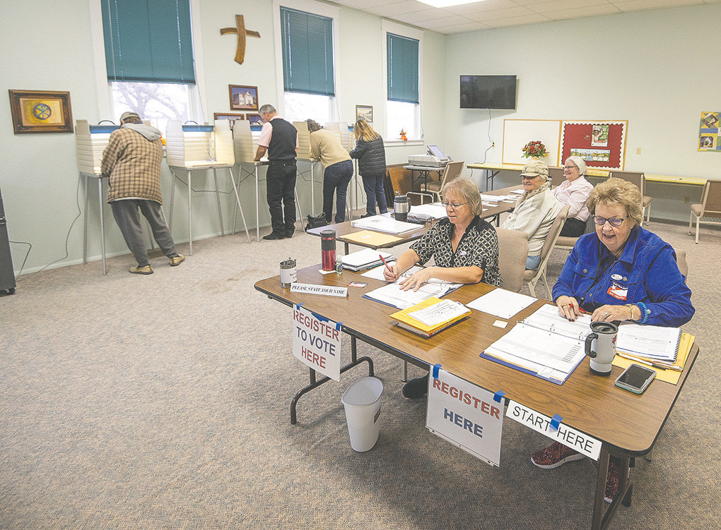 Election judges (from right) Mary Wells, Lisa Roberts, Sandy McGee and Juanita Sapp man the tables at Precinct 6-1 at the Garland Community Church of God Tuesday morning.