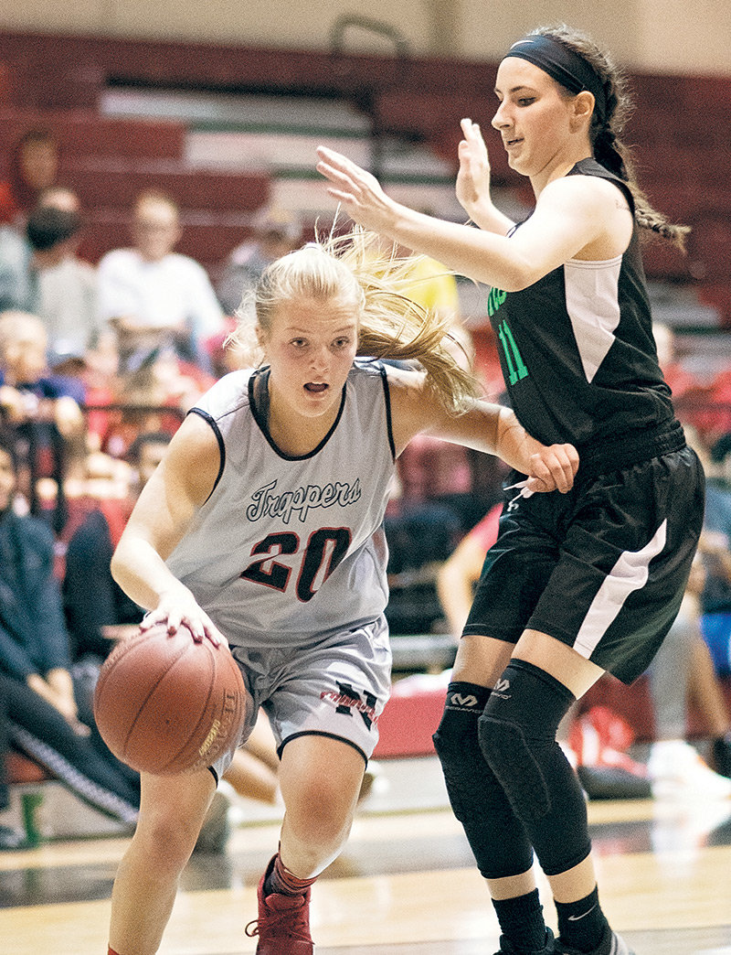 Lady Trapper Tayla Sayler dribbles past Yellowstone Christian's Majesty Pelletier during a scrimmage at Cabre Gym last month. NWC opened its season on the road last weekend going 0-2 at the Snow College Classic.
