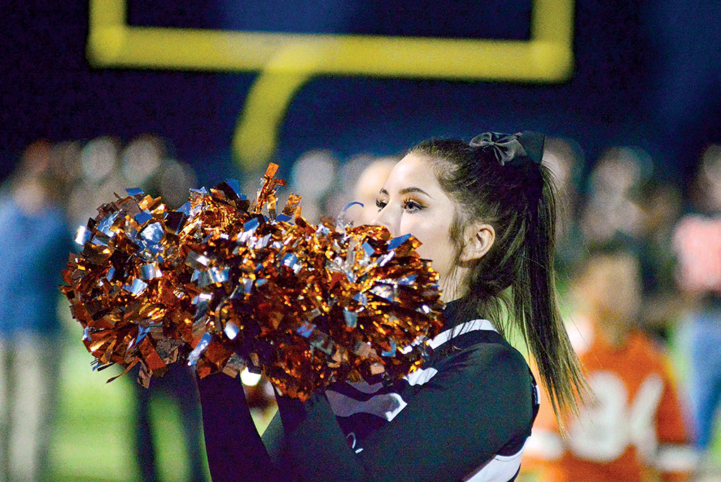Panther cheerleader Kiya McIntosh works through a routine during a Powell football game earlier this season.