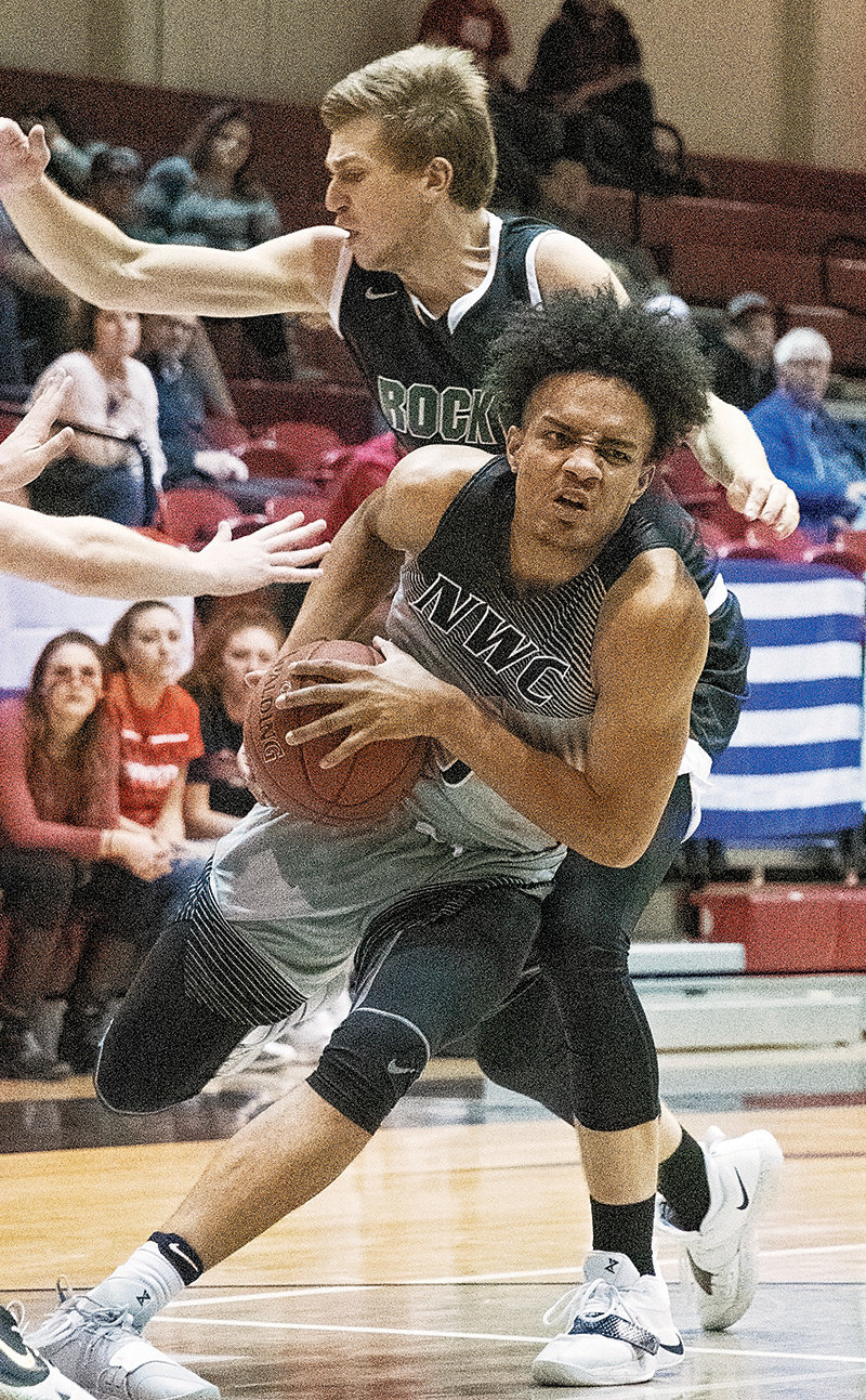 Trapper freshman Jason Feliz makes an aggressive move toward the basket Tuesday during NWC's home opener against Rocky Mountain JV at Cabre Gym. The Trappers won the contest 99-66 for the team's third straight win.