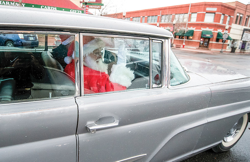 After inclement weather grounded his helicopter, Santa arrives in Powell by auto, in a 1959 Lincoln Continental, on Friday morning. He and his reindeer will hope for better conditions on Christmas Eve.