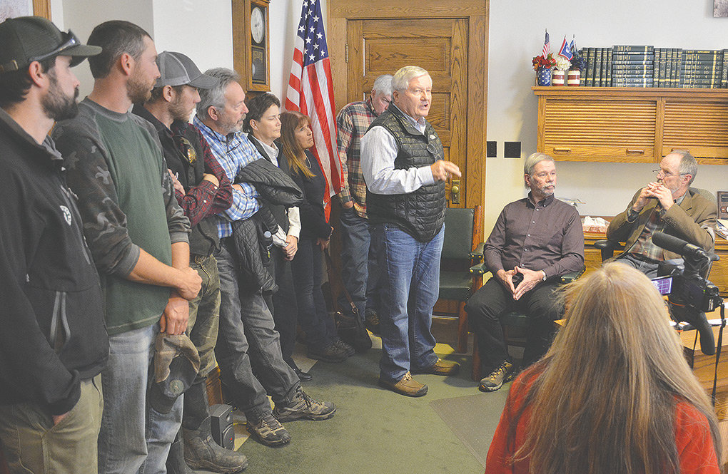 With other meeting attendees looking on, state Sen. Hank Coe, R-Cody, addresses the Park County commissioners at their Nov. 20 meeting regarding the Beartooth Ranch in Clark. 'I would urge you not to vote to repeal the MOU that we have with the federal government,' Coe said, referring to restrictions that the federal government has placed on the state-owned property.