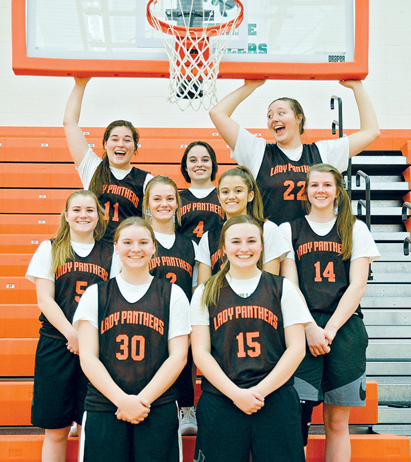 Members of the Lady Panthers basketball team smile for the camera during a break in practice last week. Powell opens the 2018-19 season this Friday at the East-West Classic in Lovell. Front row, from left: Michele Wagner, Katie McKenzie. Middle row: Ashtyn Heny, Aubrie Stenerson, Brea Terry, Devon Curtis. Back row: Jasmyne Lensegrav, Karlie McKenzie, Rachel Bonander.