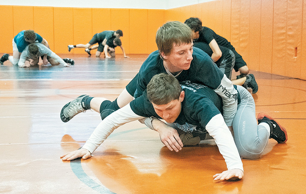 Panther wrestlers Corey Linebaugh (top) and Reese Karst work through drills during a Tuesday practice at Powell High School. Karst is the defending 3A state champion at 138 pounds, and will begin defense of his title this weekend at the Powell Invitational.