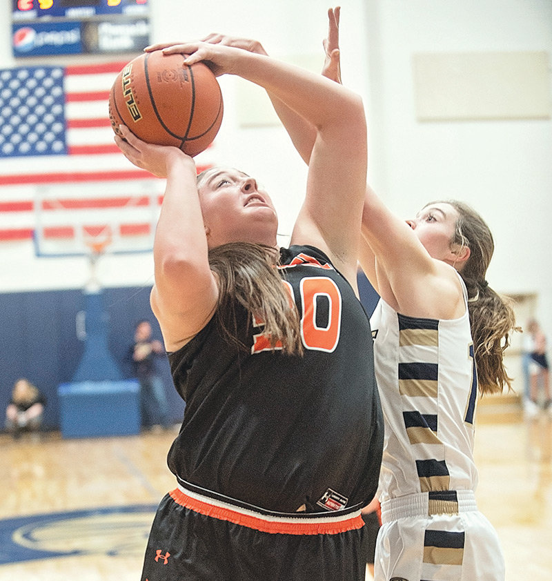 Lady Panther Rachel Bonander goes up for a shot against Cody's Paige Powell Friday at Cody High School. The Fillies pulled away from Powell in the second half to preserve the 51-26 win.