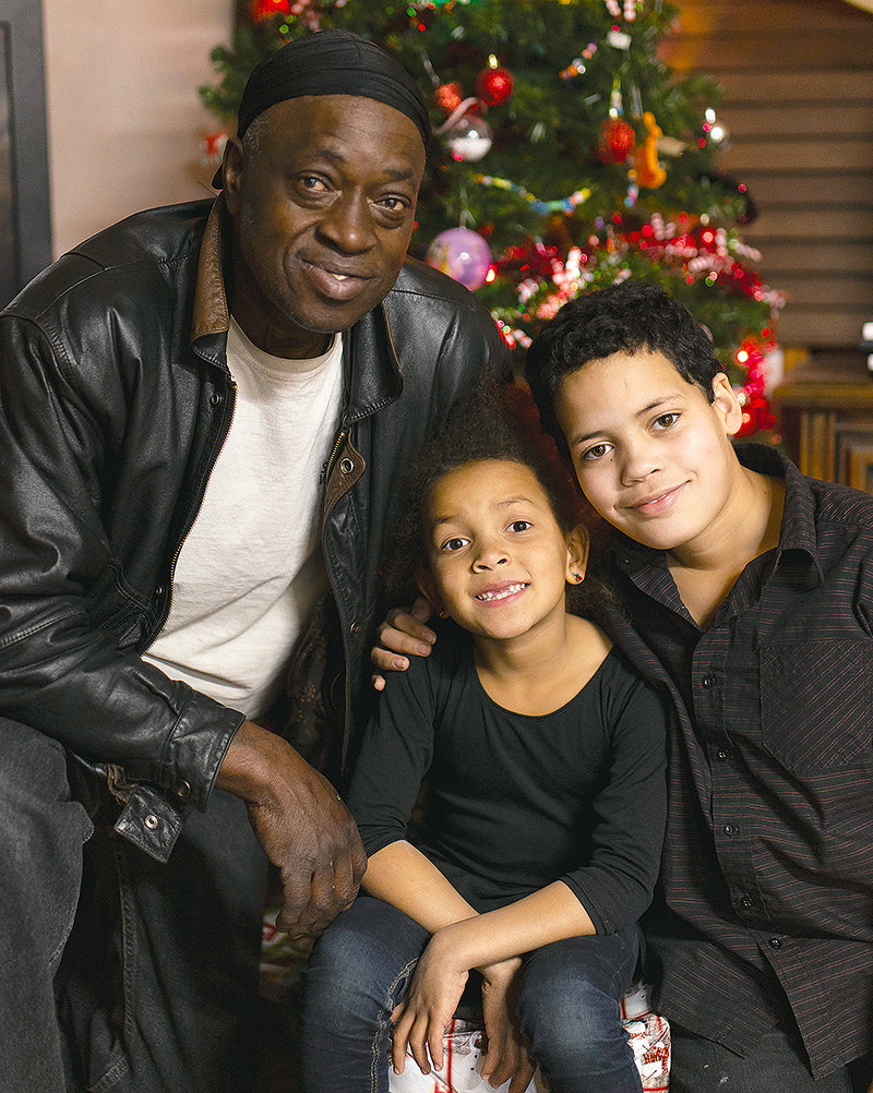 Powell resident Charles 'Moses' Graves, 11-year-old Isaac and 7-year-old Makenna pose for a photo in front of their Christmas tree. Amid some tough times for the family, 'people in Powell have definitely stepped up,' Graves said, adding, 'I can't thank them enough.'