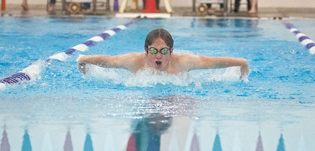 Panther swimmer Mathew Hobbs races to second place in the 100 butterfly during a Tuesday dual against Riverton at the Powell Aquatic Center.
