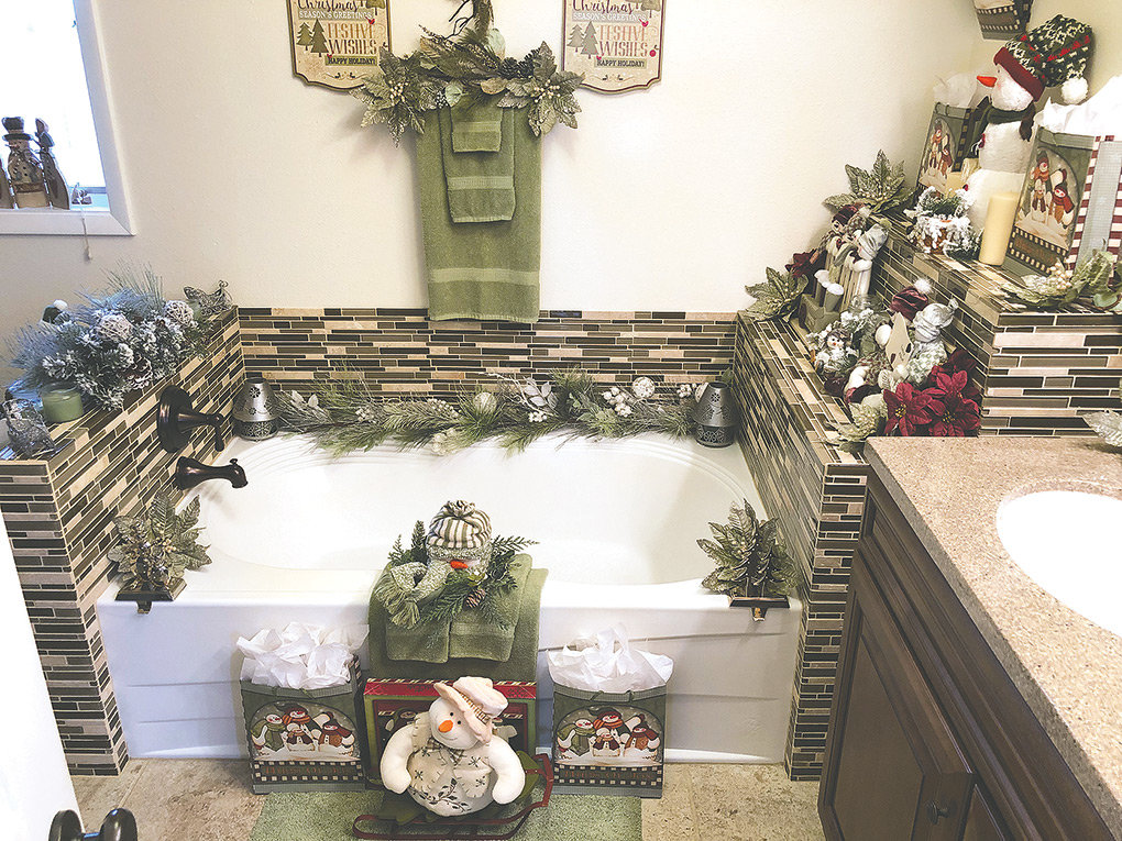 No room in the Bartles' home goes undecorated at Christmastime. Above, playful snowmen and Christmas greenery decorate the upstairs bathroom.