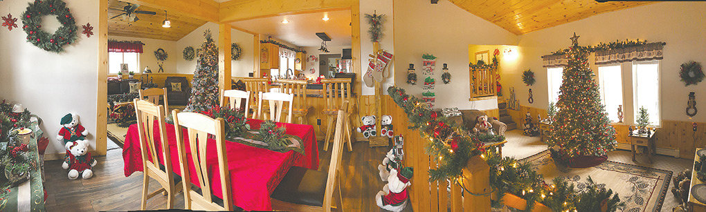 A panoramic photo shows the Bartles' recently remodeled kitchen, dining room and lower-level living room in their Christmas glory.