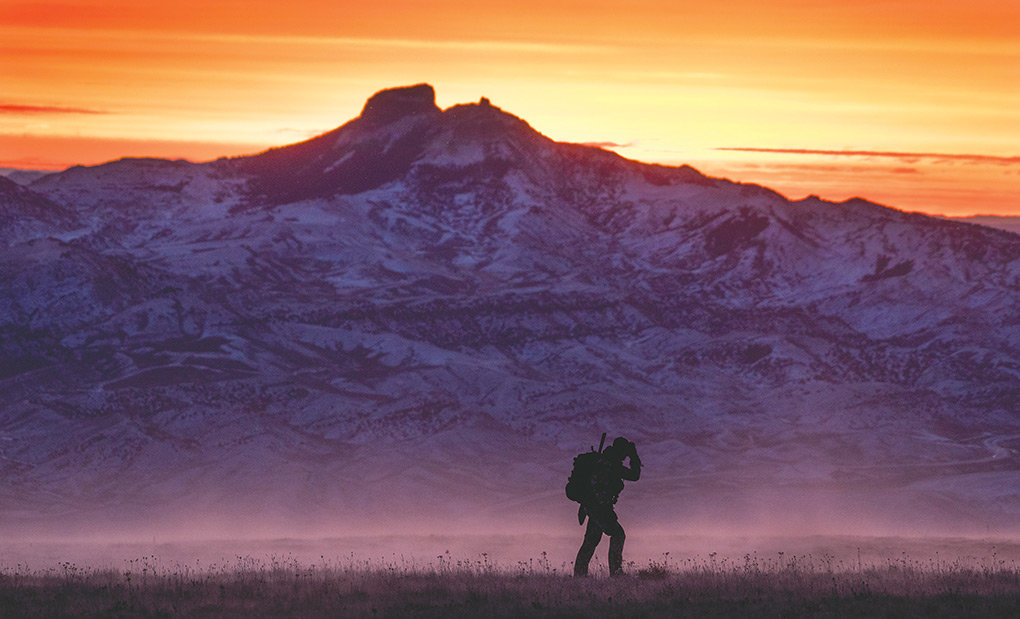 Wearing his hunting pack on his back, Garrett Burbank fights the wind near Bald Ridge while looking for elk on Saturday. Burbank's pack was stolen out of his truck at his Powell residence a week before Christmas, and then anonymously returned after the Burbank family mounted a social media campaign for its recovery. Police are investigating.
