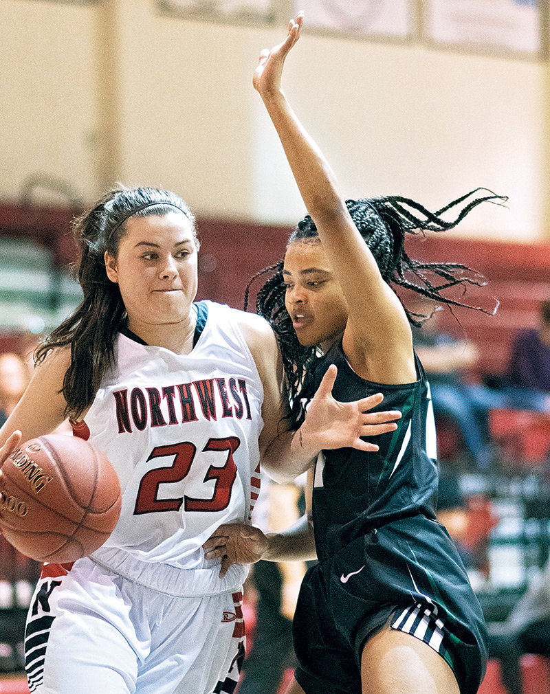 Lady Trapper Jenna Lohrenz battles past a Williston State defender Saturday at Cabre Gym. Northwest lost a one-point heartbreaker to the Lady Tetons 73-72, giving Williston State a season sweep.