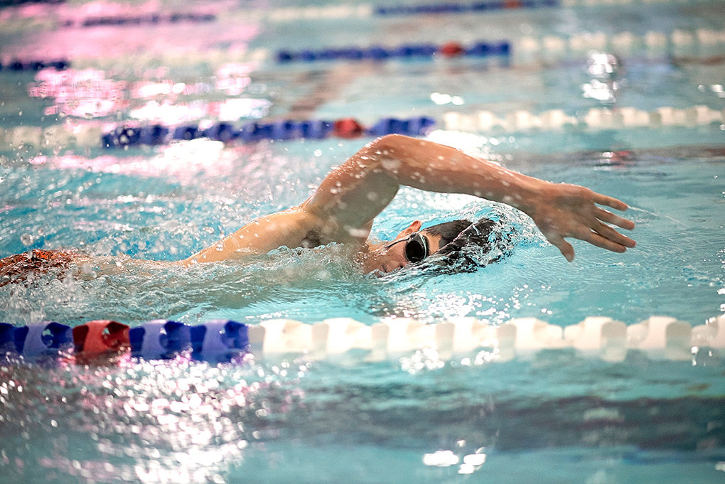 Panther senior Pedro Teixeira swims to a fifth-place finish in the 200 individual medley Tuesday during a triangular against Cody and Worland at the Powell Aquatic Center. Powell finished first as a team.