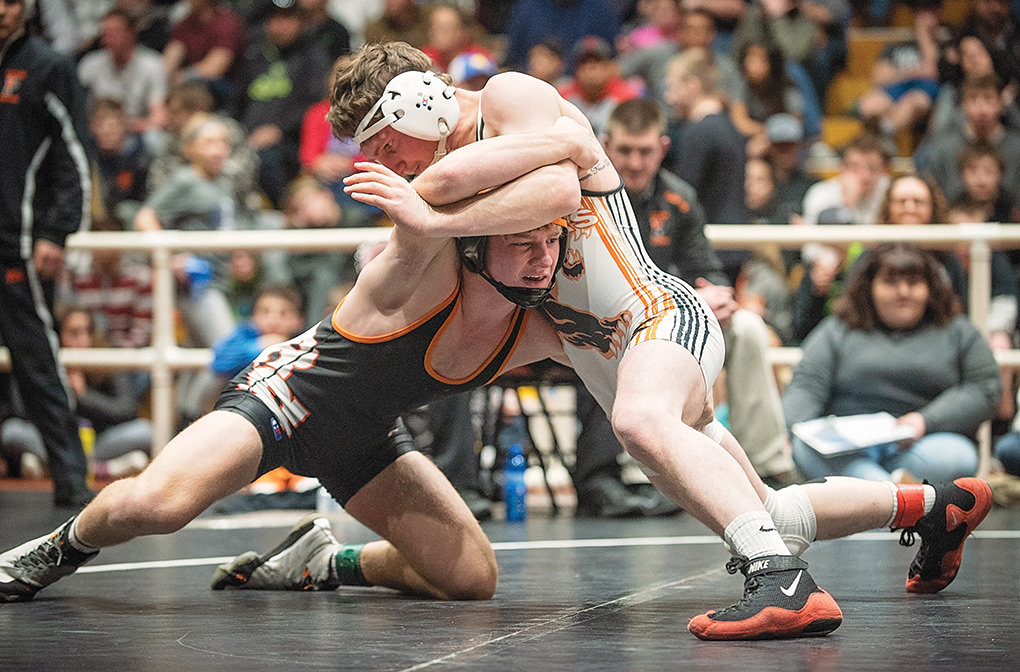 PHS senior Reese Karst battles against Rock Springs' Cameron Metcalf in the championship match at the Ron Thon Memorial Invite in Riverton Saturday. Karst took second in the tournament.