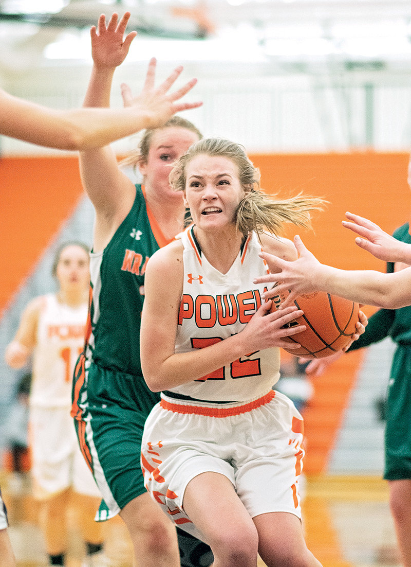 Lady Panther Aubrie Stenerson battles to keep possession of the ball Friday against Pinedale. Powell won the game 39-30 to sweep the season series against the Lady Wranglers.