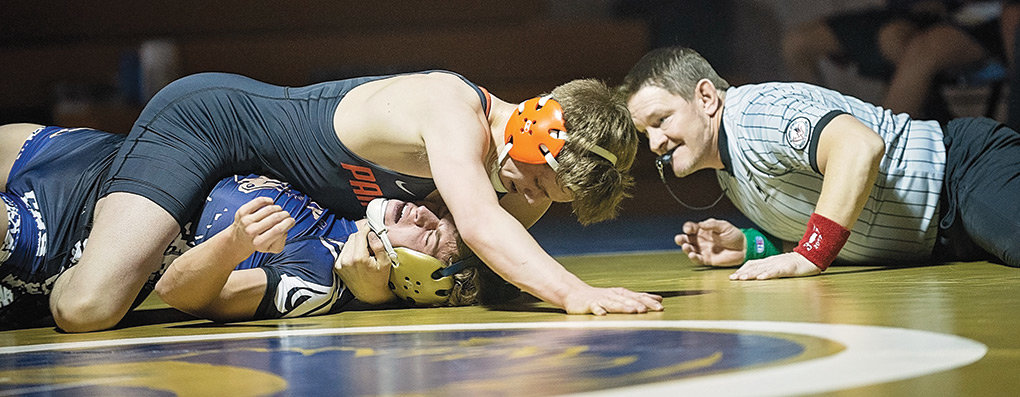 PHS senior Cole Davis works to pin Cody Bronc Tyler Grenz in the 145-pound varsity match Tuesday evening in Cody.