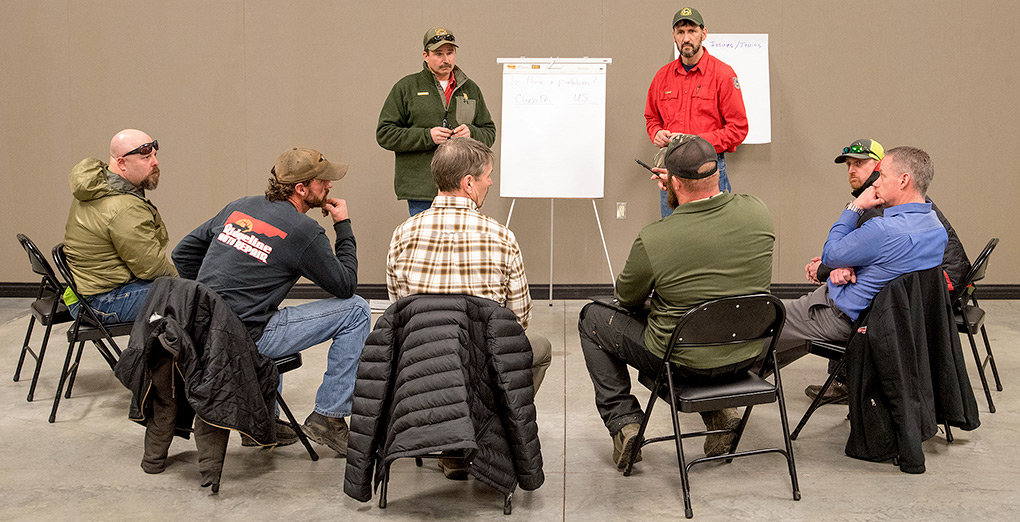 Powell Game Warden Chris Queen (left) and Wyoming Game and Fish Terrestrial Habitat Biologist Jerry Altermatt lead a discussion about local mule deer herd numbers at the Park County Fairgrounds on Feb. 19. The meeting was an effort to gauge support for possible regulations to help boost mule deer herd numbers.