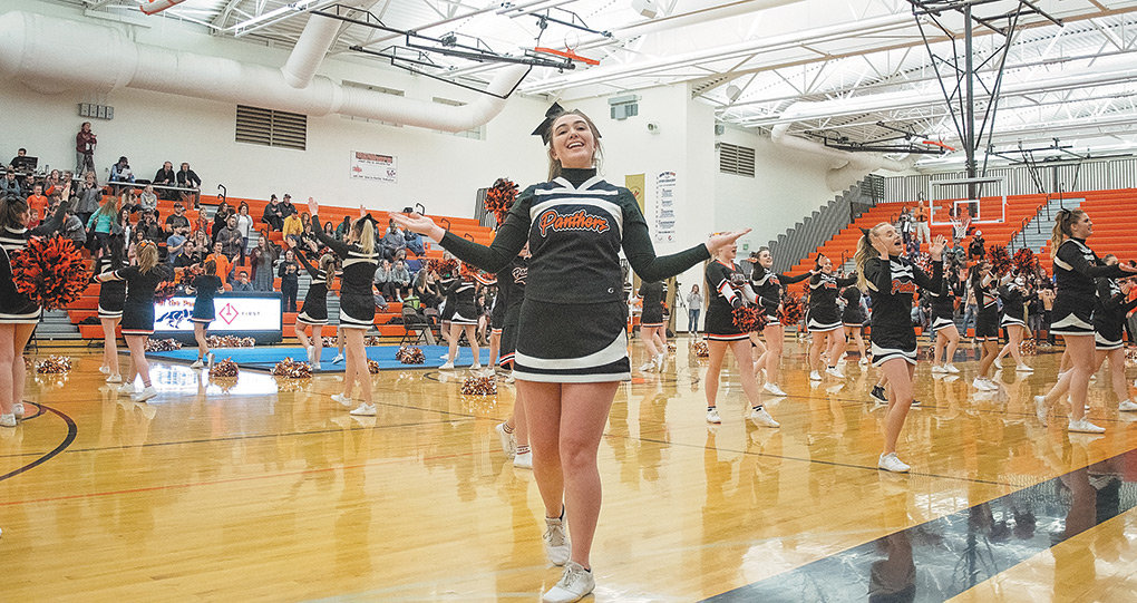 PHS cheerleader Gracie McLain and her teammates perform at halftime of a recent basketball game at Panther Gym. The cheer team will compete at the 3A State Cheer Competition Wednesday at the Casper Events Center.
