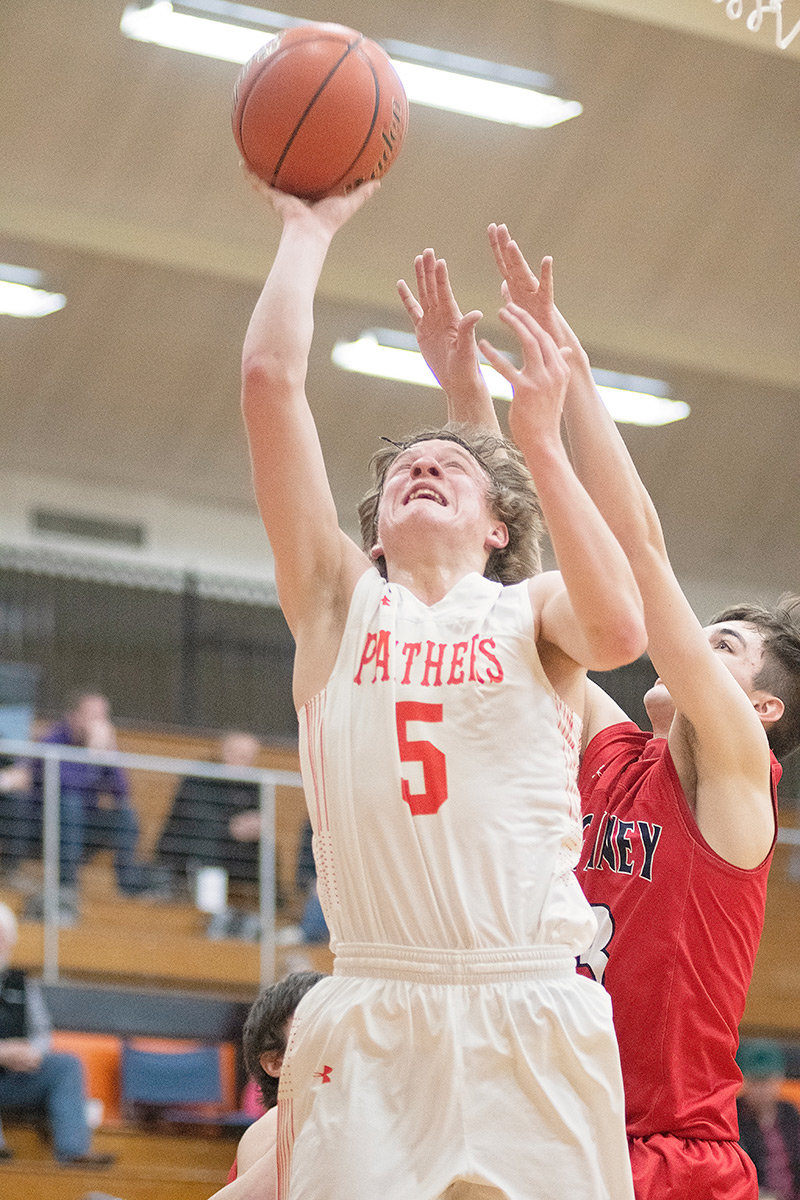 Panther senior William Preator scores two of his 10 points over a Big Piney defender during Powell's 61-39 win over the Punchers in the 3A West Regional Tournament. The Panthers head to the state tournament Thursday as the No. 2 seed out of the 3A West.