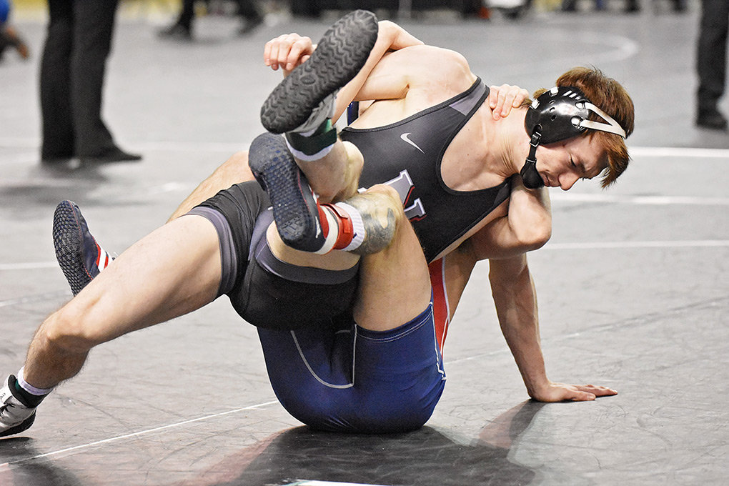 At 149 pounds, NWC's Palmer Schafer works for an advantage against Clackamas' Martin Margolis III in the opening round of the  NJCAA National Championships. Schafer finished 1-2 for the tournament.