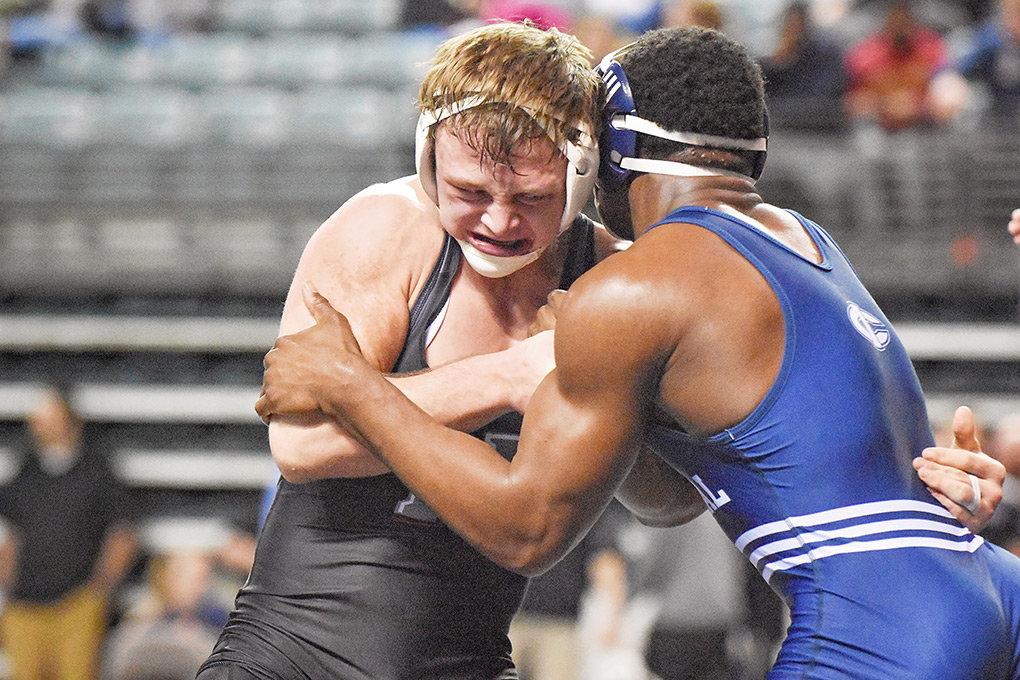 Trapper wrestler Porter Fox, left, tangles with Iowa Central's Brian Stanford in the 184-pound class of the NJCAA National Championships in Council Bluffs, Iowa. Fox finished with a 1-2 record for the tournament.