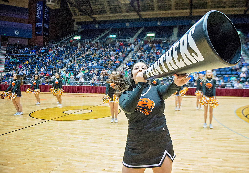 Scarlette Mendoza leads the PHS cheer team during halftime of the 3A state title game in a performance of their state-championship winning Game Day Cheer routine at the Casper Events Center Saturday.