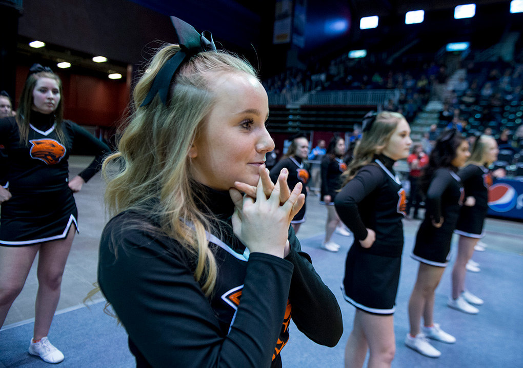 Morgan Schmidt watches the action anxiously with her teammates late in the second half of the Powell-Lander 3A state title game.