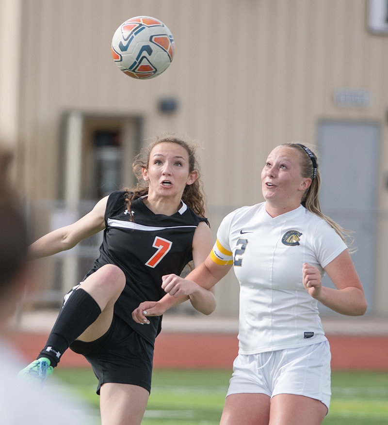 PHS forward Malia Hedges battles Cody's Moran Heydenberk for the ball Thursday during a game at Panther Stadium. The Fillies won the battle of Park County rivals 5-0.