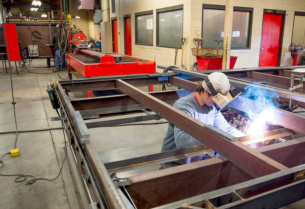 Mason Webster, a student at Northwest College, welds on a trailer during class on Wednesday afternoon. As part of their response to declining enrollment, NWC leaders plan to develop more trade programs.