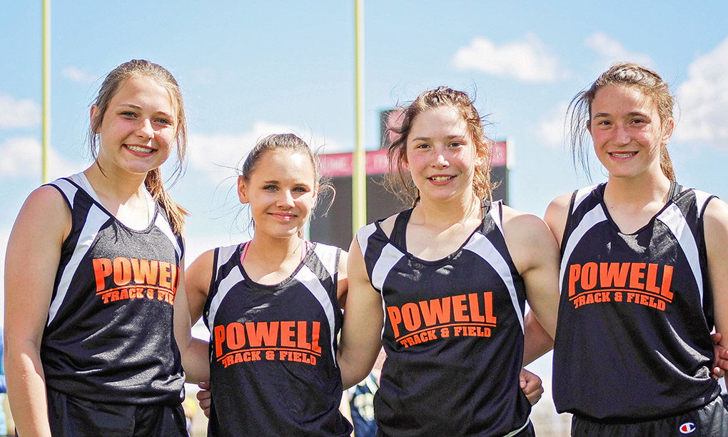 Powell Middle School track athletes Sydney Spomer, Vanessa Richardson, Kami Jensen and Mikayla Graham are all smiles at last weekend's Spartan Invitational in Riverton.