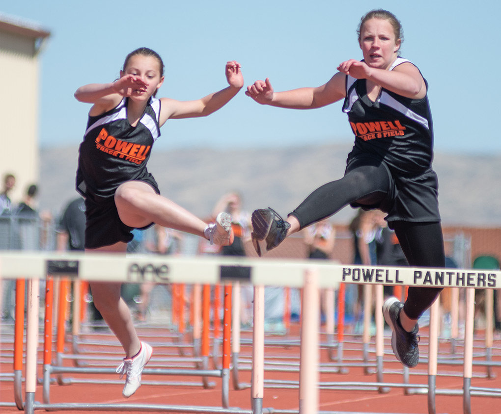 Lady Cub hurdlers Aramonie Brinkerhoff, left, and Victoria Beaudry head for the finish line in the 100 meter hurdles Saturday at Panther Stadium. Beaudry finished seventh in the event with a time of 21.23; Brinkerhoff was ninth, finishing in 21.56.