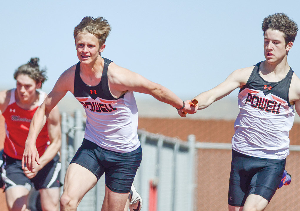 PHS sprinter Landon Lengfelder, right, passes the baton to teammate Kaelan Groves during a running of the 4x100 relay at the Cody Invitational last month. Groves and Lengfelder, along with teammates Kadden Abraham and Riley Bennett, finished second in the 4x100 at Thursday's Laurel Invitational, prequalifying as a team for state.