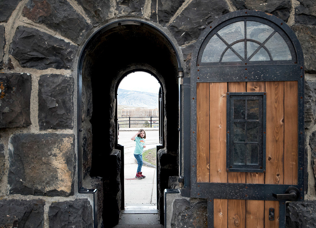 A young visitor from New York — on an 18-day vacation with her family — checks out the Roosevelt Arch at Yellowstone National Park's North Entrance last week. Although visitation has been rising, 'the narrative that the park is being overrun is not true,' said Yellowstone Superintendent Cam Sholly.