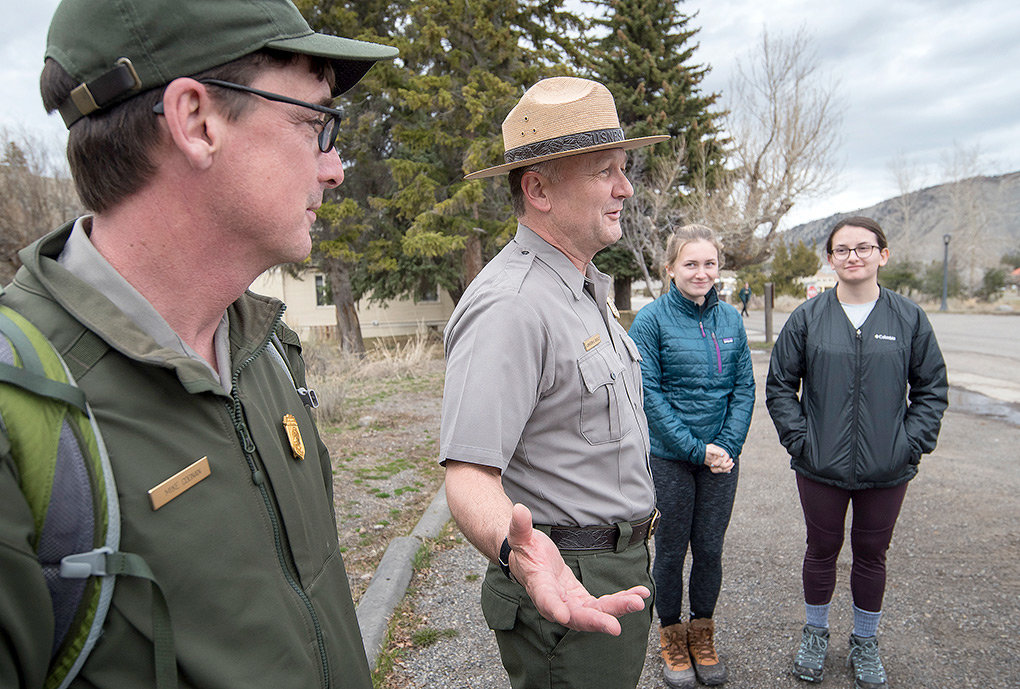 New Yellowstone National Park Superintendent Cameron 'Cam' Sholly talks with a group of visiting students from New York alongside park employee Mike Coonan (left) last week. After arriving in October, Sholly is entering his first summer season at the park.