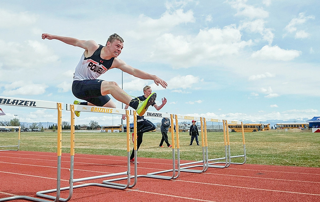 PHS sprinter Kadden Abraham hurdles to a third-place finish in the 100 meter hurdles at the Rocky Mountain Invitational in Cowley on Saturday. Abraham also placed first in the 300 meter hurdles. The Panthers and Lady Panthers both finished first in the six-team field.