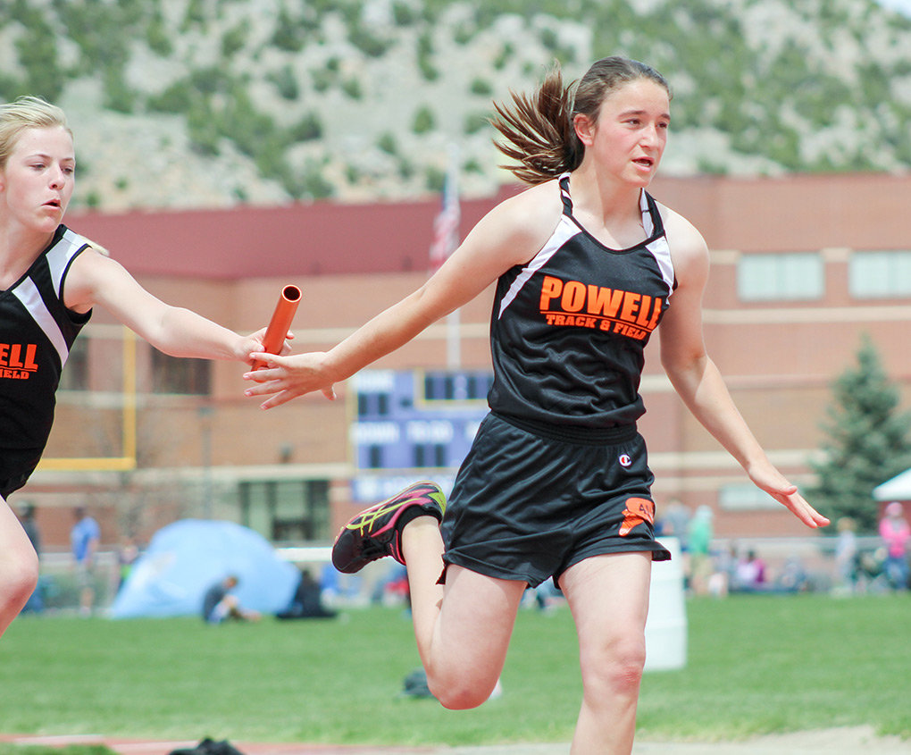 Lady Cub Blake Nissen (left) hands off the baton to teammate Mikayla Graham during the Yellowstone Conference Meet in Thermopolis last weekend.