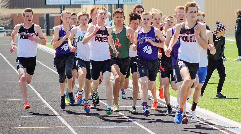 Aiden Jacobsen (left), Jayden Yates (center) and Jay Cox (right) of Powell High School battle for positioning amid a pack of opponents during the 800 meter run at regionals. Fellow Panther Ethan Bartholomew is pictured in the pack.
