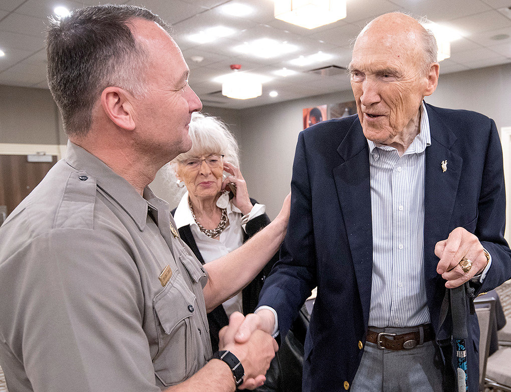 Yellowstone National Park Superintendent Cameron Sholly is greeted by former U.S. Sen. Al Simpson and his wife, Ann, at the Cody Country Chamber of Commerce's National Parks Day luncheon on Monday.