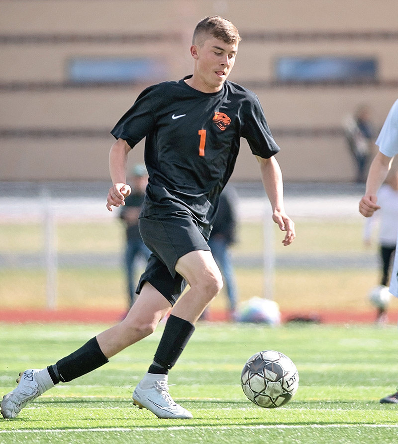 PHS senior Rob Sessions brings the ball up the pitch during a recent game at Panther Stadium. Sessions overcame a slow start to become an integral part of the Panthers' offense late in the season.