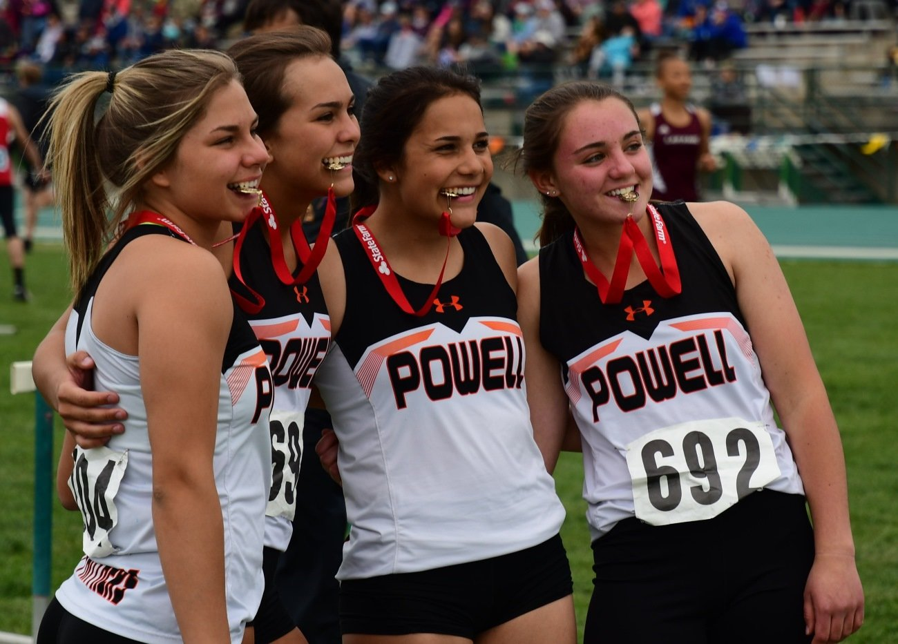 The 4x100 relay team of (from left) Caitlyn Miner, Jaz Haney, Emma Karhu and Jayden Asher are all smiles as the pose with their championship medals at the 3A Track and Field Championships on Friday.