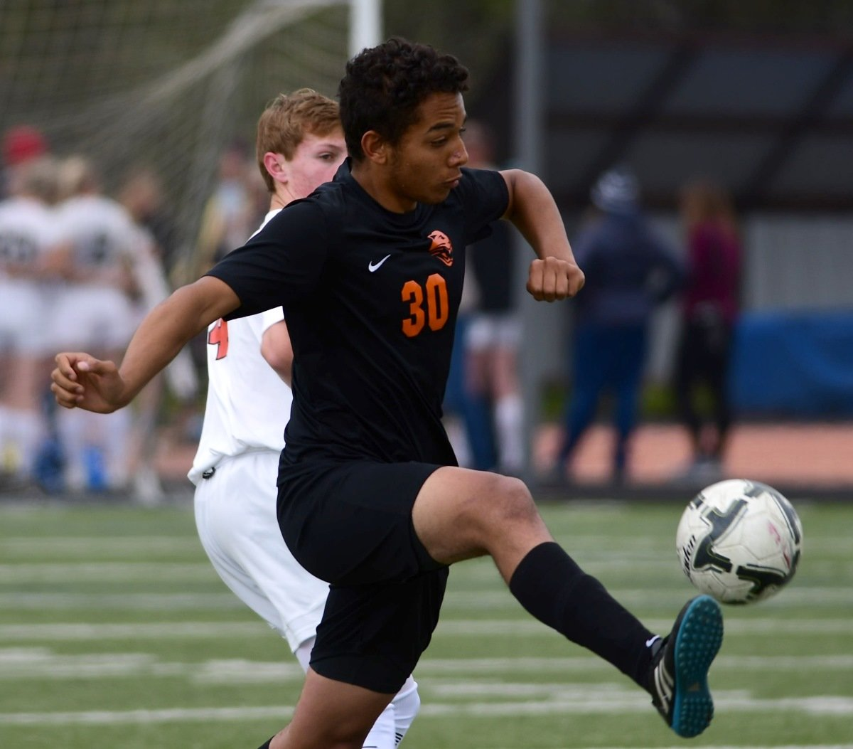 Panther forward Kaleb Brown boots the ball in the first half of the 3A State Championship game against Worland. The Warriors won 2-0 to secure their second straight state title.